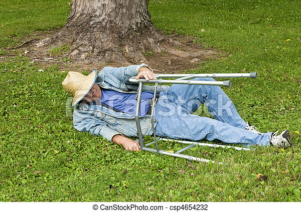man with a walker falling down in the park - csp4654232
