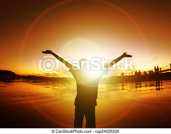 Man with arms outstretched Silhouette Freedom Sunset Energy Life - csp24026226
