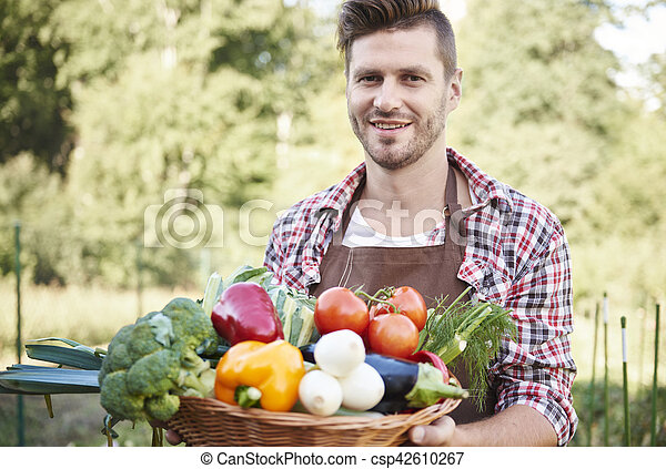 Man with basket full of vegetables - csp42610267