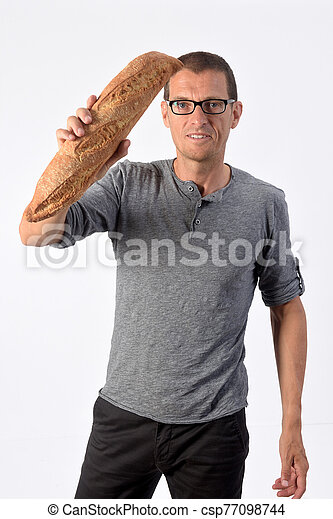 man with bread on white background - csp77098744