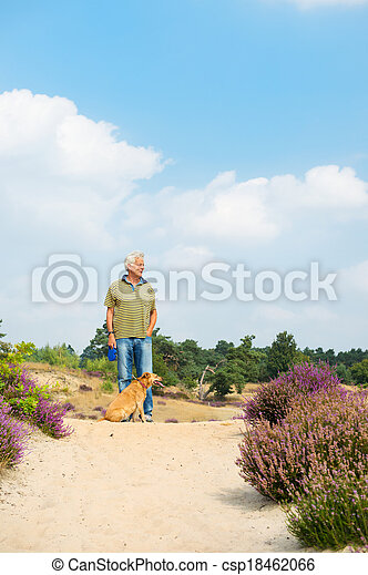 Man with dog in nature - csp18462066
