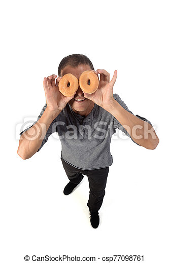 man with donut on white background - csp77098761