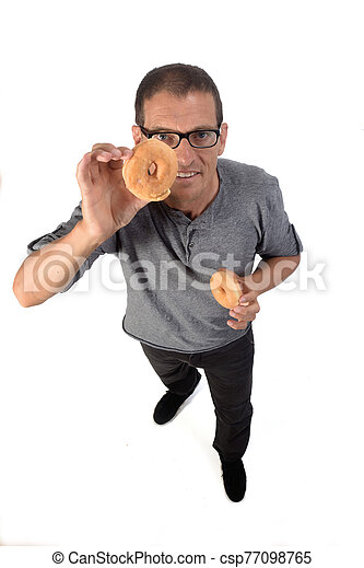 man with donut on white background - csp77098765