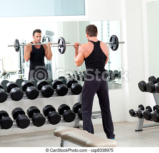 man with dumbbell weight training equipment  gym - csp8338975