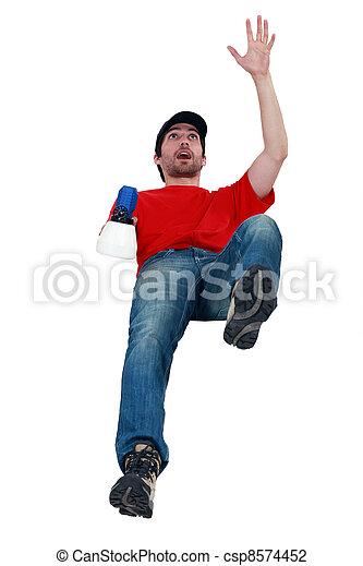 Man with gun falling painting - csp8574452