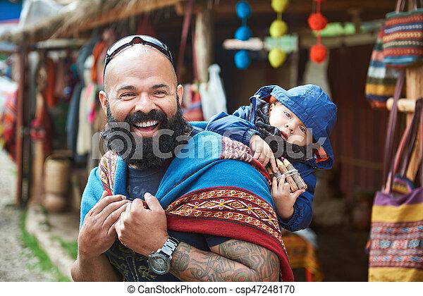 Man with kid in Peru market - csp47248170