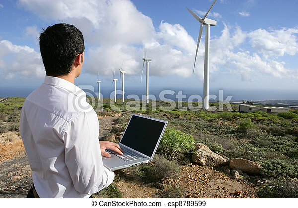 Man with laptop in wind farm - csp8789599