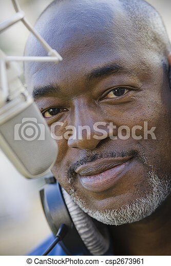 Man with Microphone and Headphones - csp2673961