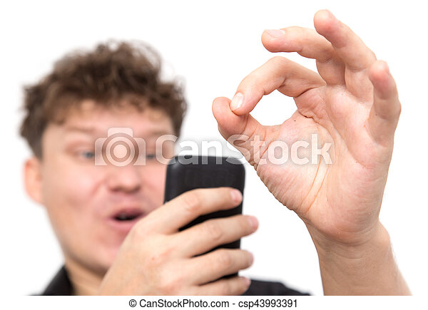 man with phone on a white background - csp43993391