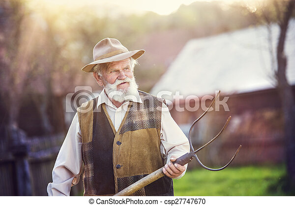 Man with pitchfork - csp27747670