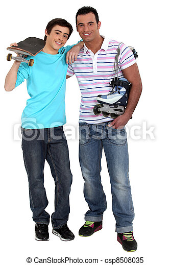 Man with rollerblades and teen carrying skateboard