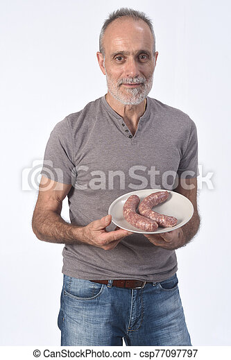 man with sausage on white background - csp77097797