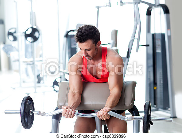 man with weight training equipment on sport gym - csp8339896
