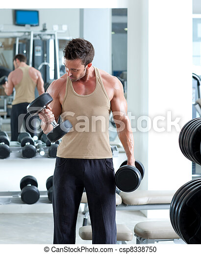 man with weight training equipment on sport gym - csp8338750
