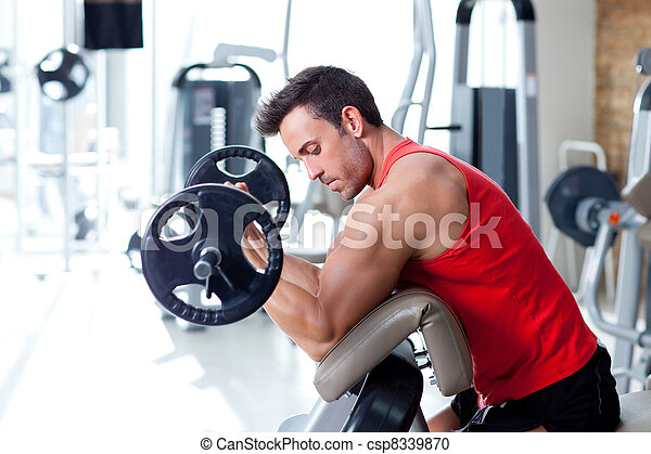man with weight training equipment on sport gym - csp8339870