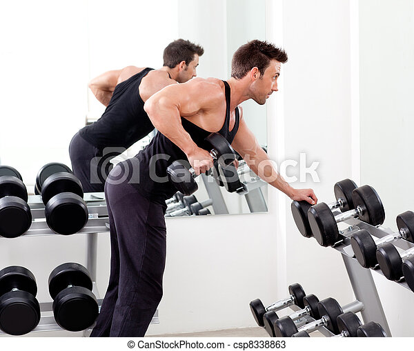 man with weight training equipment on sport gym - csp8338863