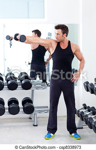 man with weight training equipment on sport gym - csp8338973