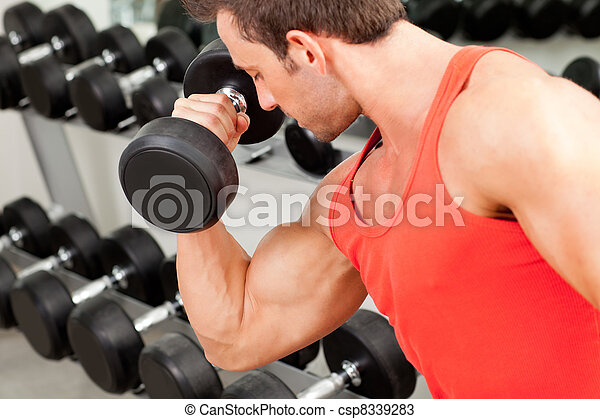 man with weight training equipment on sport gym - csp8339283
