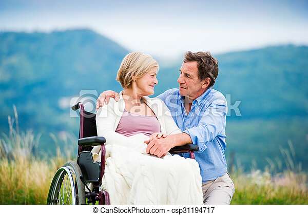 Man with woman in wheelchair - csp31194717