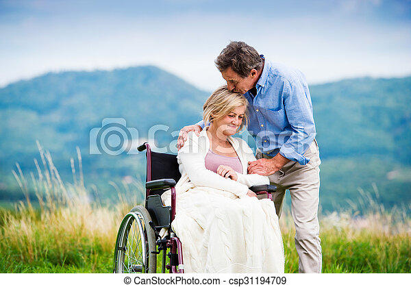 Man with woman in wheelchair - csp31194709