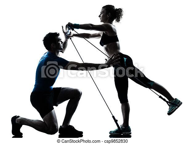 man woman exercising gymstick workout fitness - csp9852830
