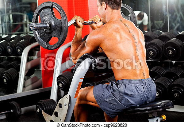 man working out with barbell in gym - csp9623820