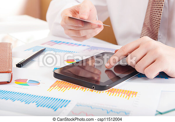 Man working with modern devices - csp11512004