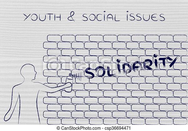 Man writing solidarity as wall graffiti youth social issues man writing solidarity as wall graffiti youth social issues csp36694471 ccuart Image collections