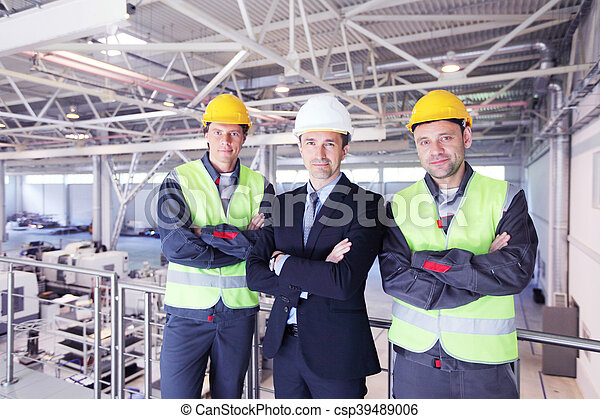 Manager and workers in factory - csp39489006