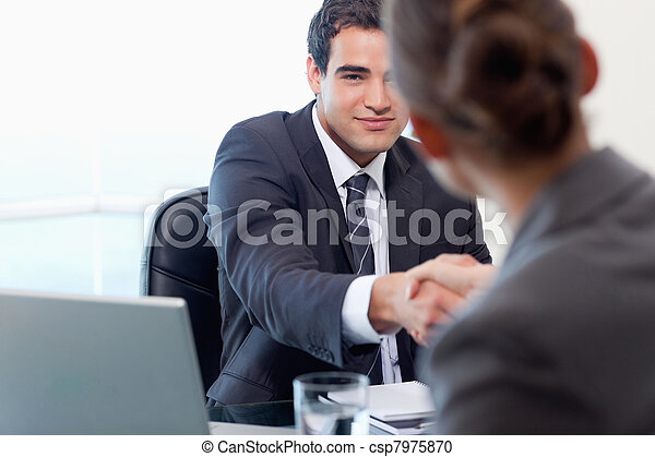 Manager interviewing a female applicant - csp7975870