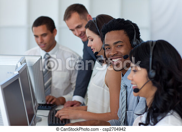 Manager talking to his business team in a call center - csp2704942