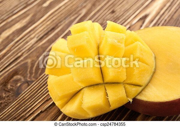 Mango fruit on wood - csp24784355