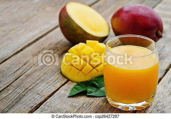 mango juice and fresh mango - csp26427287