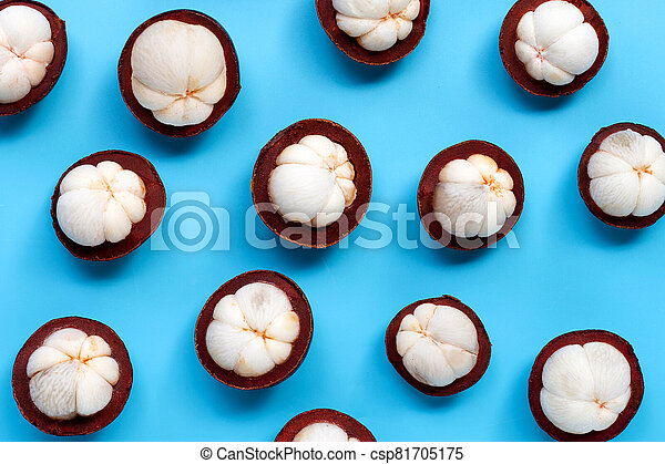 Mangosteen on blue background. Top view - csp81705175