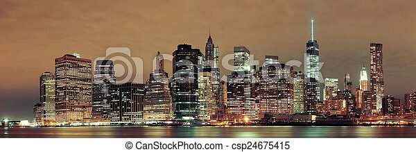 Manhattan at night - csp24675415