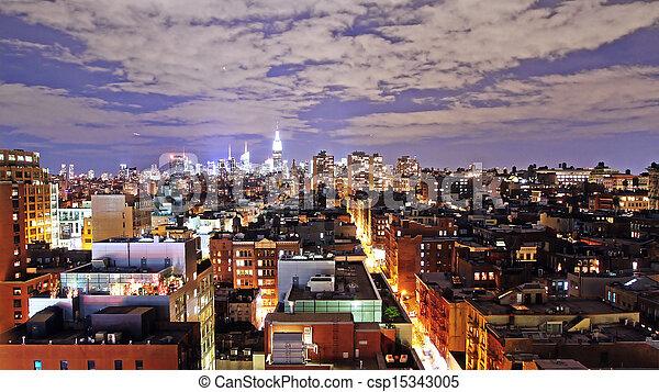 Manhattan at night - csp15343005