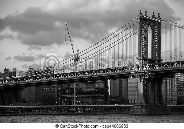 Manhattan bridge over the river and the city in black and white style, New York - csp44066983