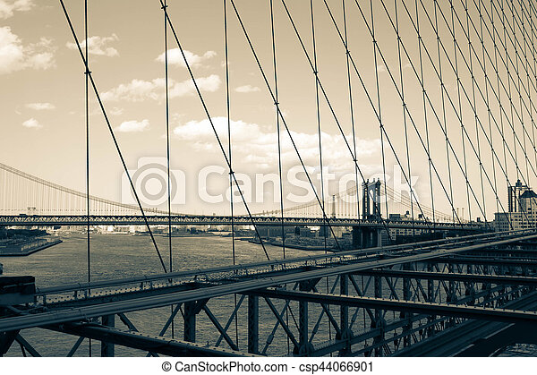 Manhattan bridge over the river from Brooklyn bridge's view in vintage style, New York - csp44066901
