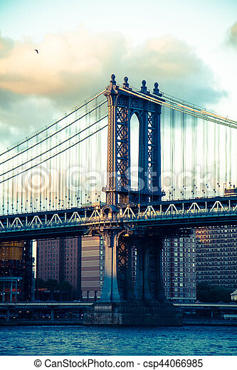 Manhattan bridge with cloudy sky before sunset in vintage style, New York - csp44066985
