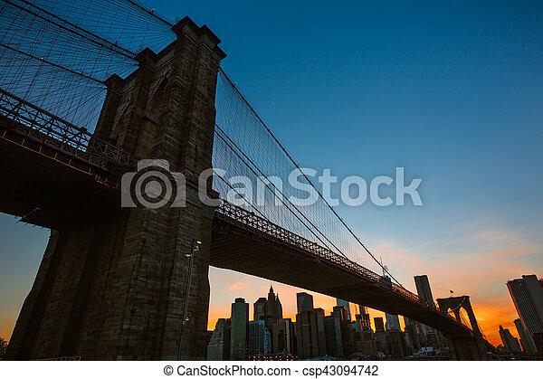 Manhattan skyline with Brooklyn Bridge - csp43094742