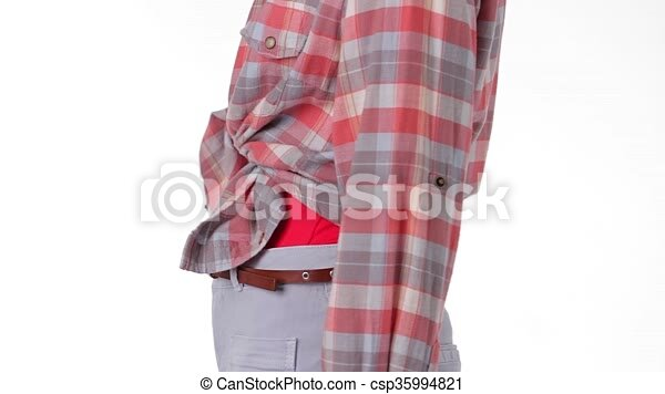 ed13fd7ec774 Mannequin in checkered shirt turning. woman s bright chekered shirt. tied  shirt and thin belt. trendy look for warm season.