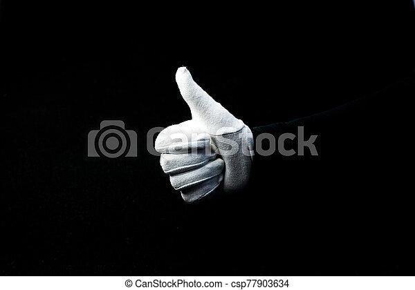 mano, blanco, actuación, señal, guante, llevando, aprobar, plano de fondo, negro - csp77903634