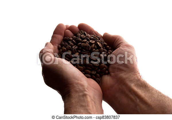 Man's hand a handful of coffee beans - silhouette - csp83807837