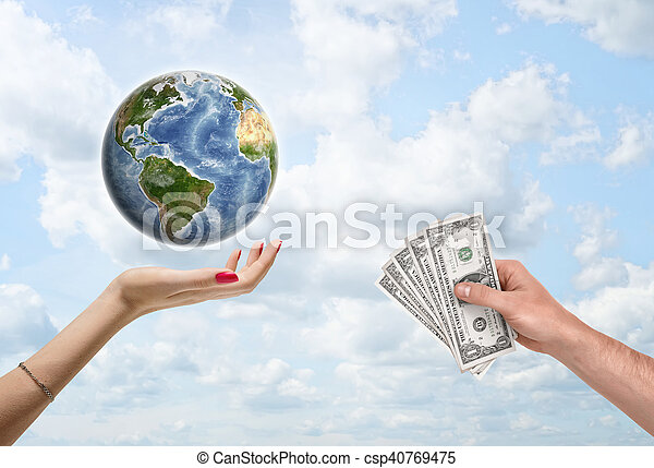 Man\'s hand giving dollar bills to a female hand, which supports the planet Earth. Donating money to worldwide conservation and environmental organizations. Environment and ecology. Save planet. Elements of this image are furnished by NASA.