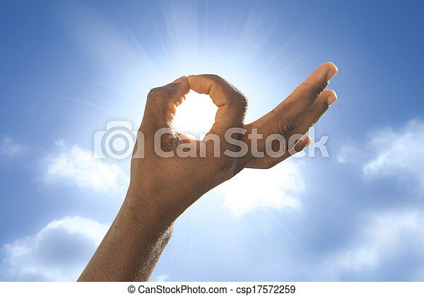 Man's hand in front of the sun - csp17572259