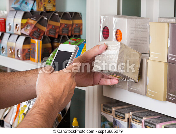 Man's Hand Scanning Product Through Mobile Phone - csp16685279