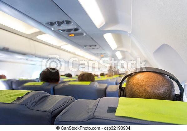 Man's head in headphones - csp32190904