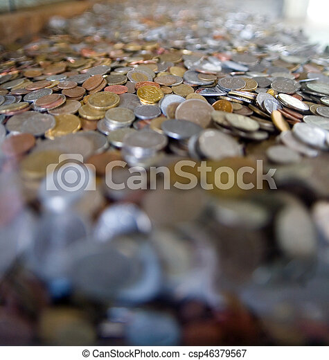 Many coins from different countries of the world. - csp46379567