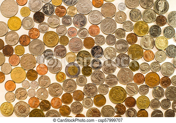 Many coins from different countries of the world - csp57999707