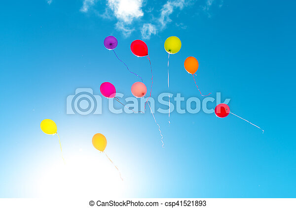 Many colorful baloons in the blue sky. - csp41521893